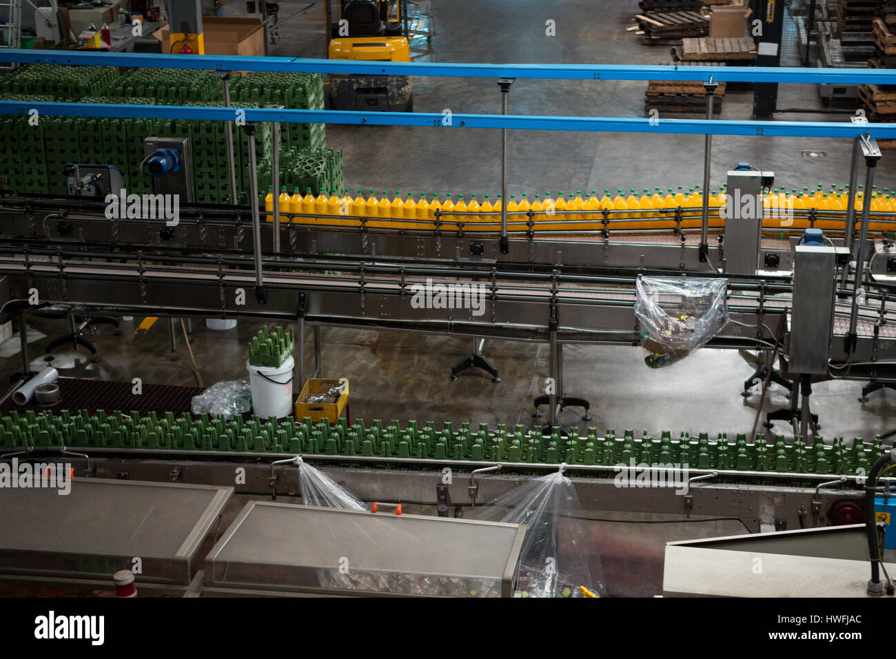 High angle view of bottles on production lines in juice factory Stock Photo