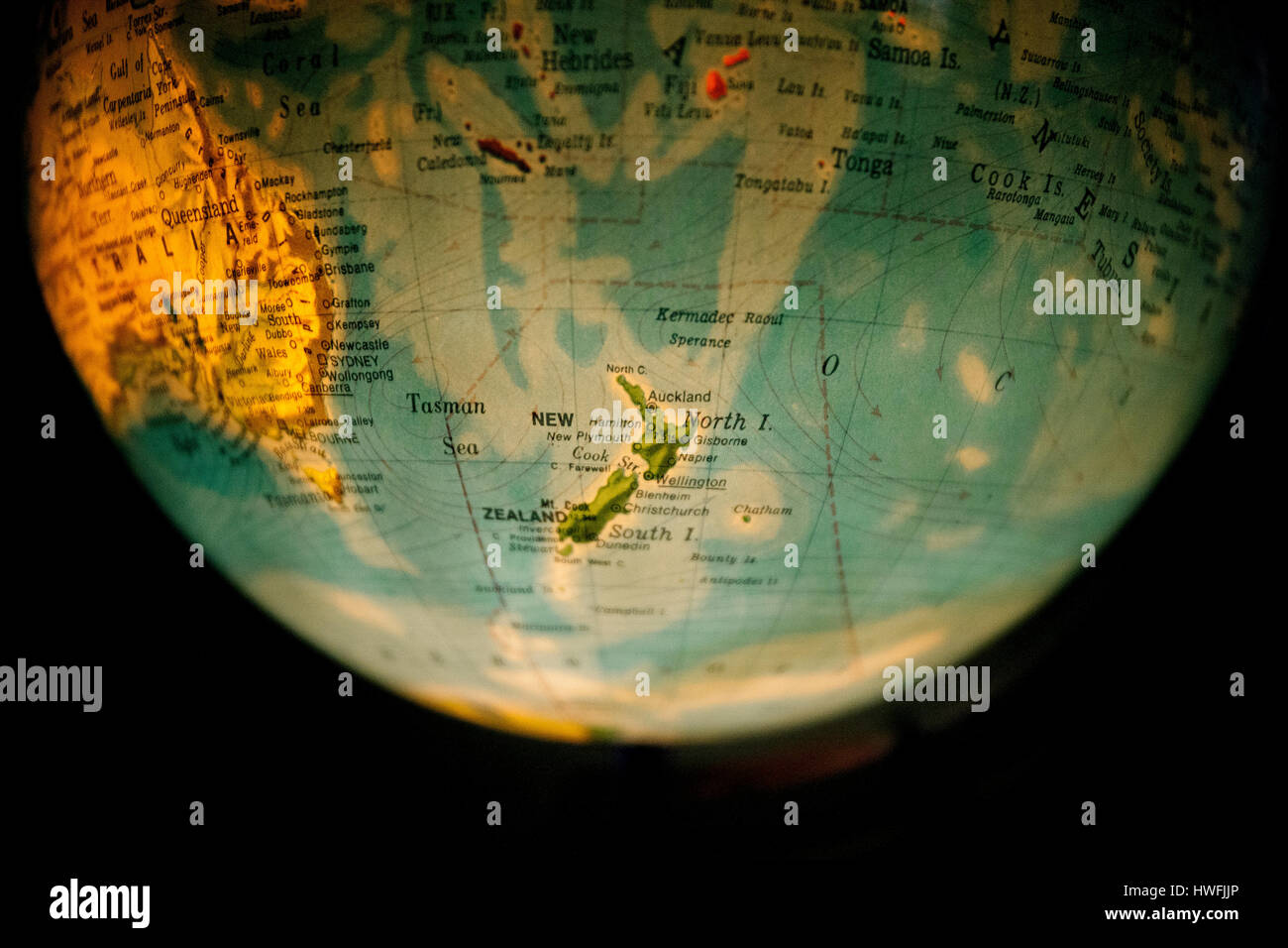 close up of old fashioned world globe a ball shaped map lit from within focusing on Mongolia china - Stock Image
