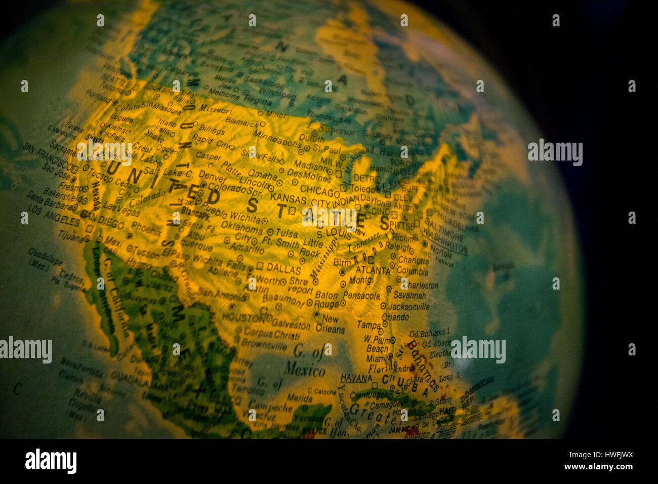 Close up of old fashioned world globe a ball shaped map lit from close up of old fashioned world globe a ball shaped map lit from within focusing on united states gumiabroncs Images