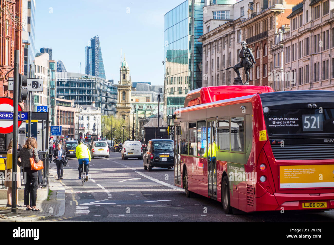 Street view of a bus and taxi in traffic on Holborn with City of London skyline, UK. - Stock Image