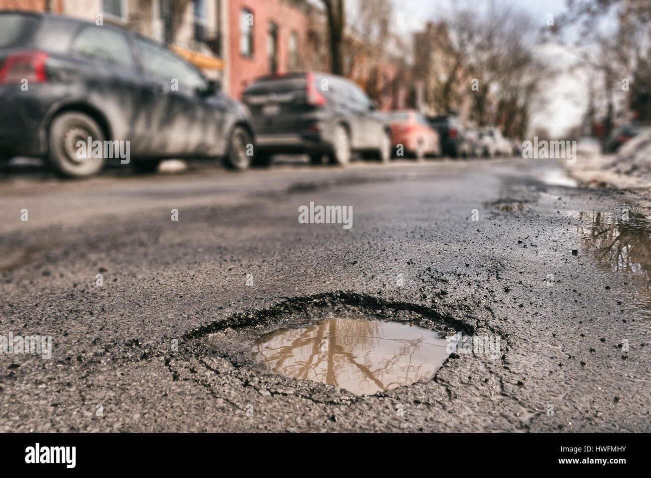 Large pothole in Montreal, Canada. - Stock Image