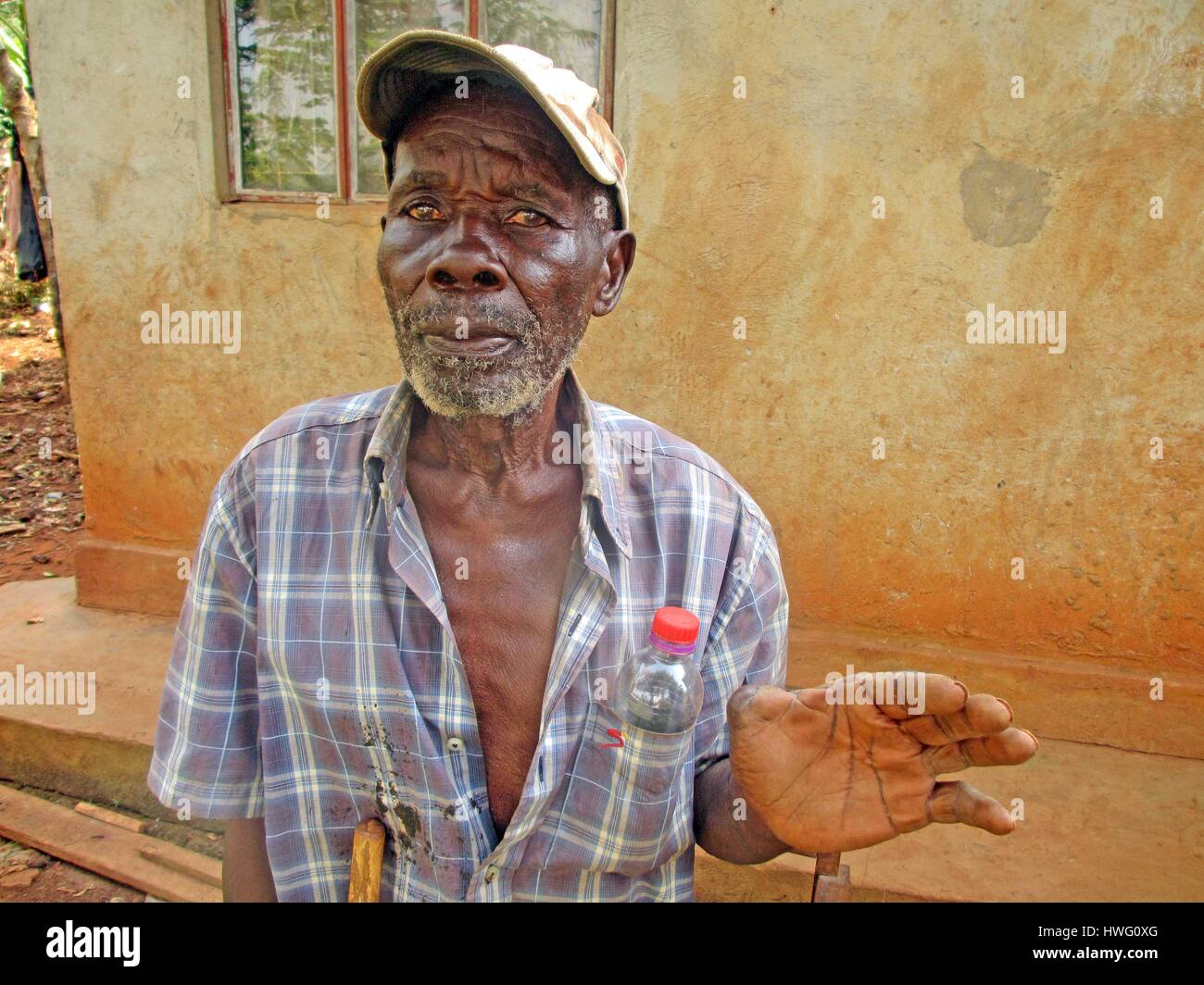 World War II veteran Aloysius Lubega is seen in front of his home in Mugomba village, Uganda, on February 09, 2017. - Stock Image