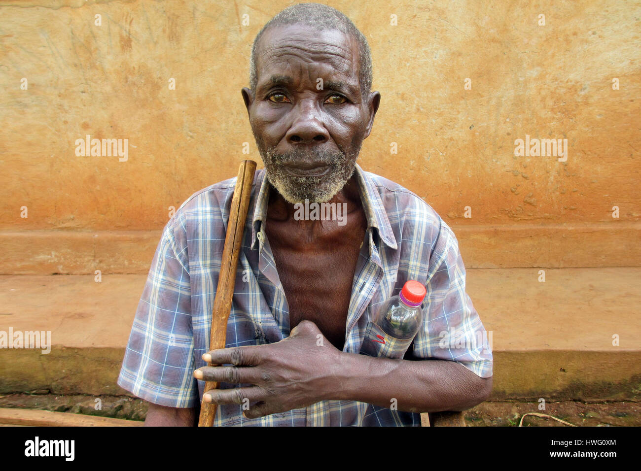 World War II veteran Aloysius Lubega is seen in front of his home in Mugomba village, Uganda, on February 09, 2017. Stock Photo