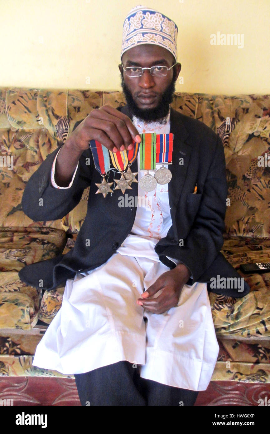 Ramadan Tambula, representative of Uganda Ex-Servicemen·s Association, shows medals of his greatgrandfather - Stock Image
