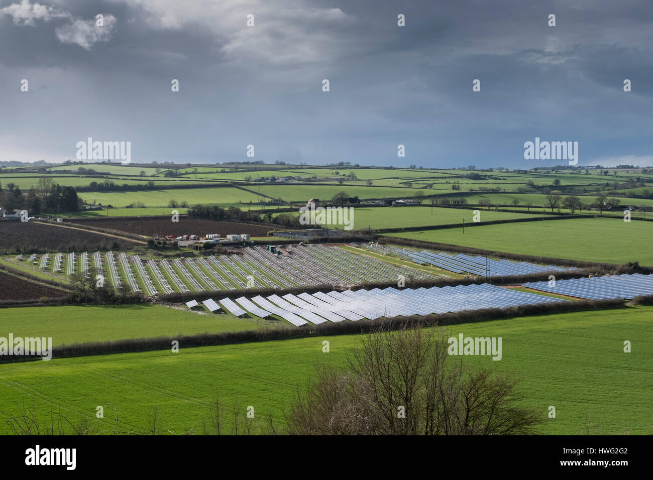 Milborne Port, Somerset, UK. 21st March 2017. A Solar Farm under construction amongst the fields in the spring sunshine. Stock Photo