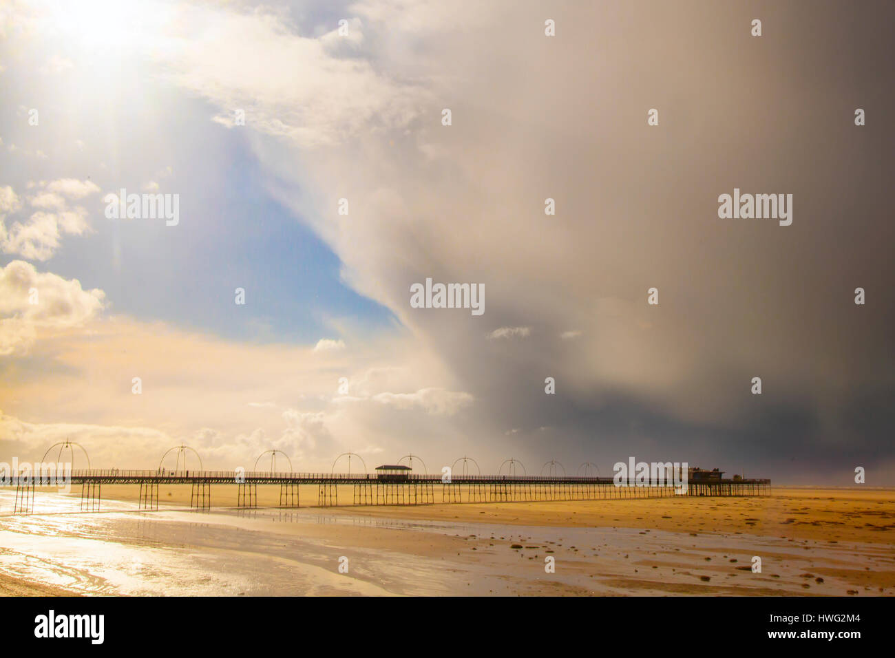 Southport, Merseyside, UK. UK Weather. 21st March 2017. Storm Clouds over Southport Pier and heavy showers over - Stock Image