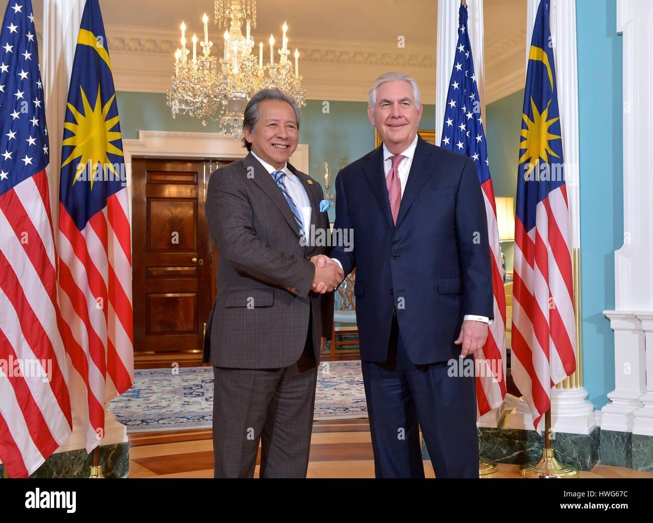 Washington, USA. 21st Mar, 2017. U.S. Secretary of State Rex Tillerson greets Malaysian Foreign Minister Dato Sri Stock Photo
