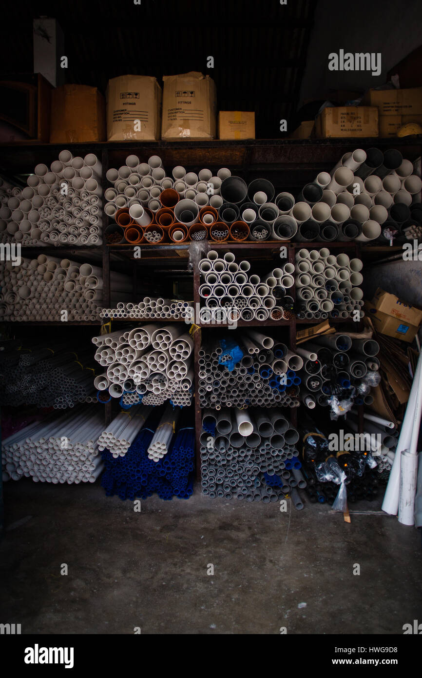 Boxes of grey and white plastic pipes - Stock Image