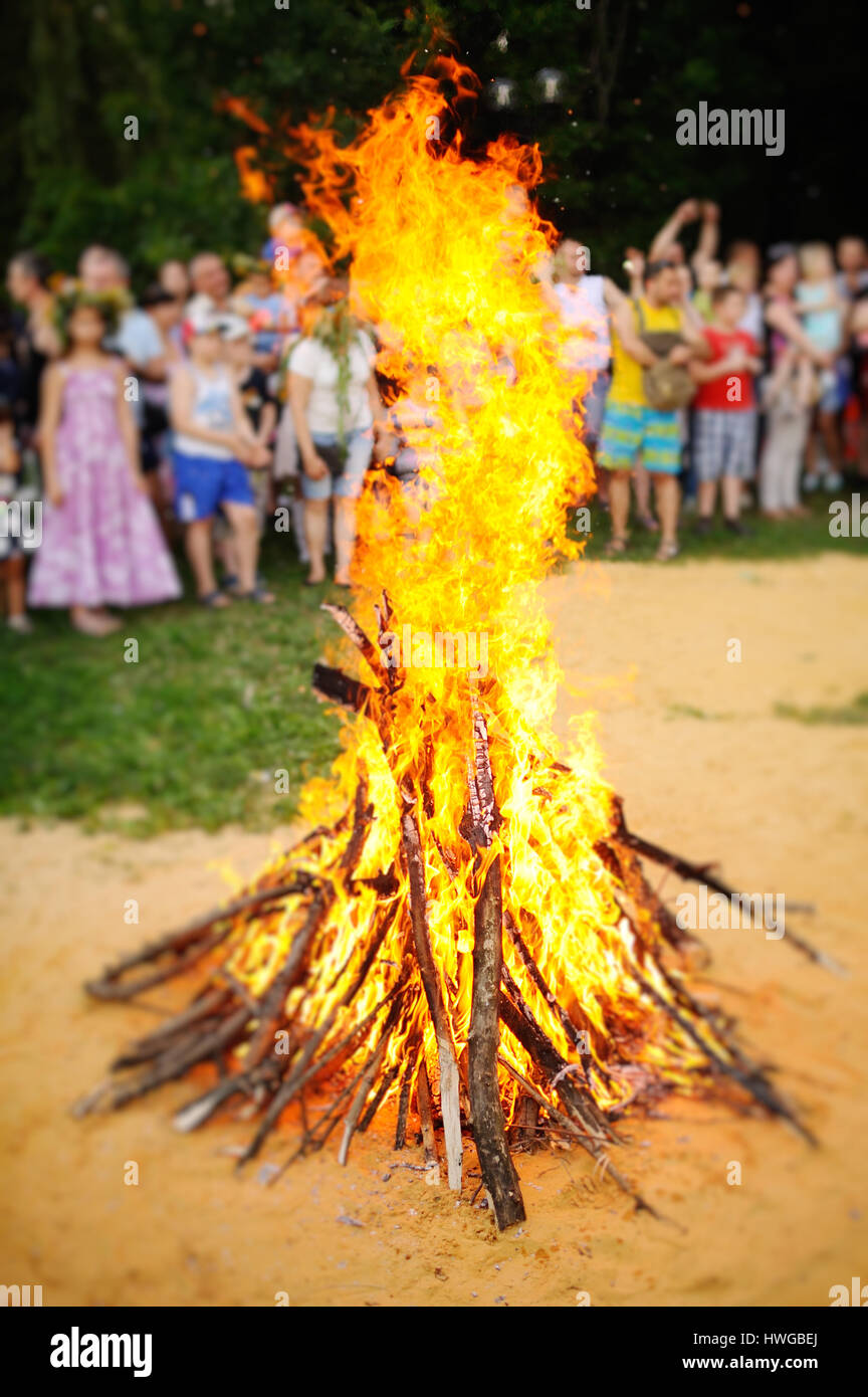 Large Bonfire on the background of people - Stock Image