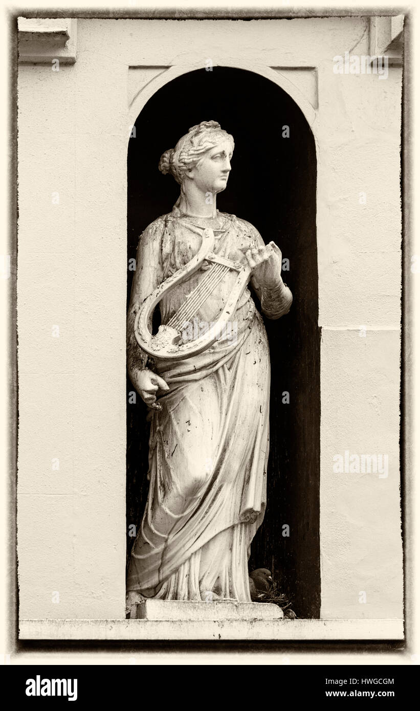 Cirencester - Statue of woman with lyre in alcove of building at Dollar Street, Cirencester, Gloucestershire in - Stock Image