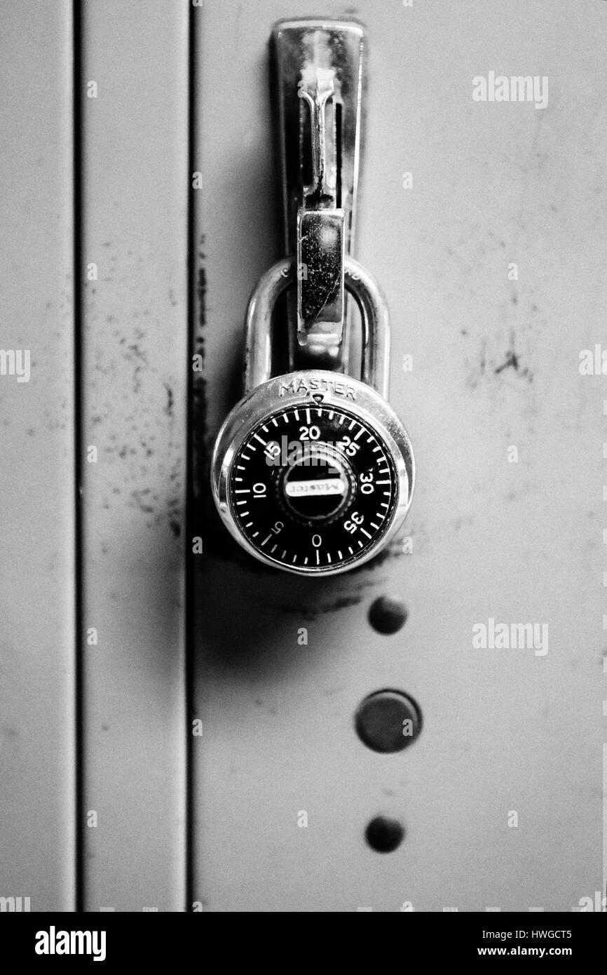 Padlock on an old wall locker. - Stock Image