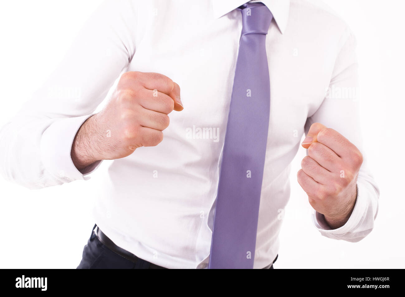 Businessman punching the air. - Stock Image