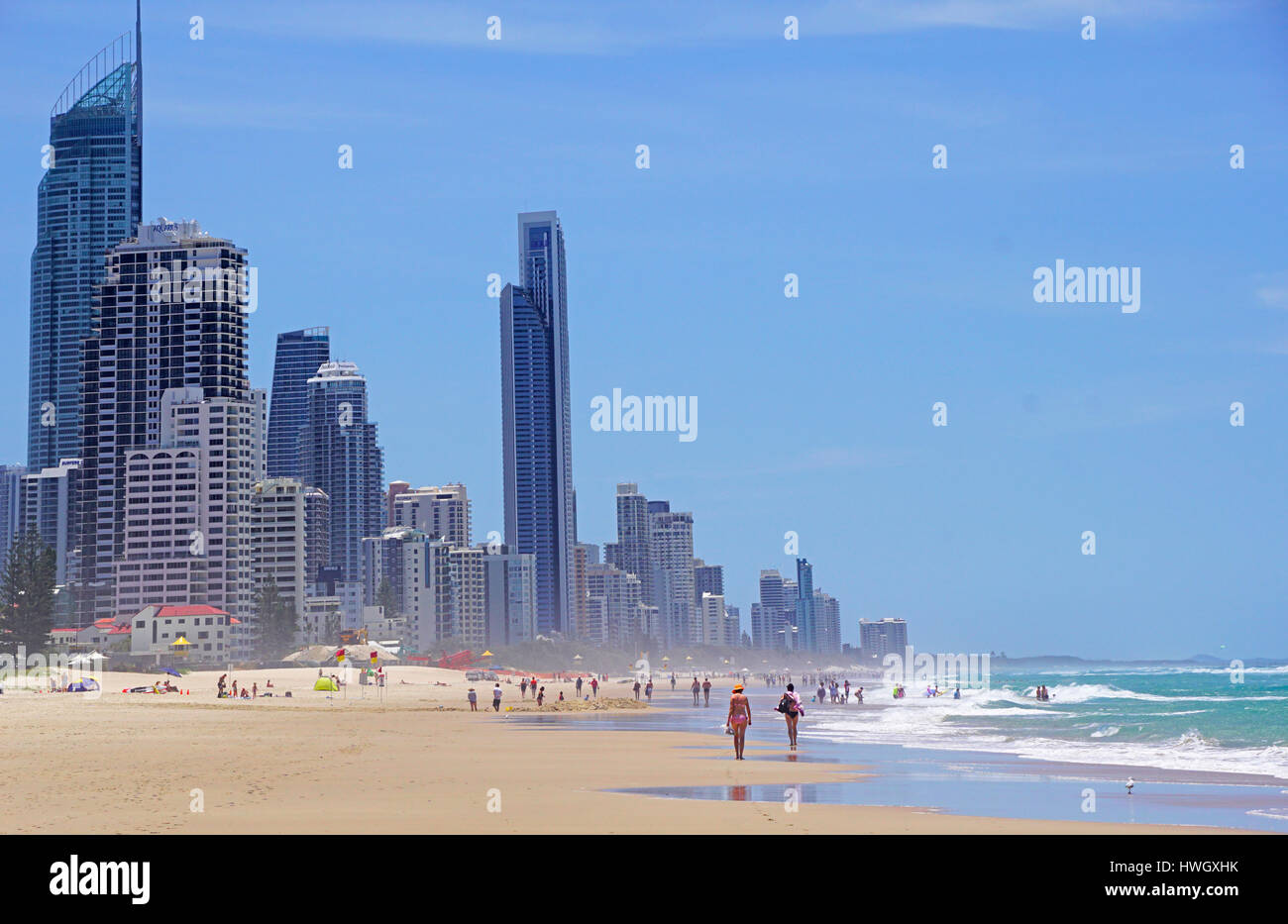 Swimmers on beach at Surfers Paradise, Queensland, Australia. - Stock Image