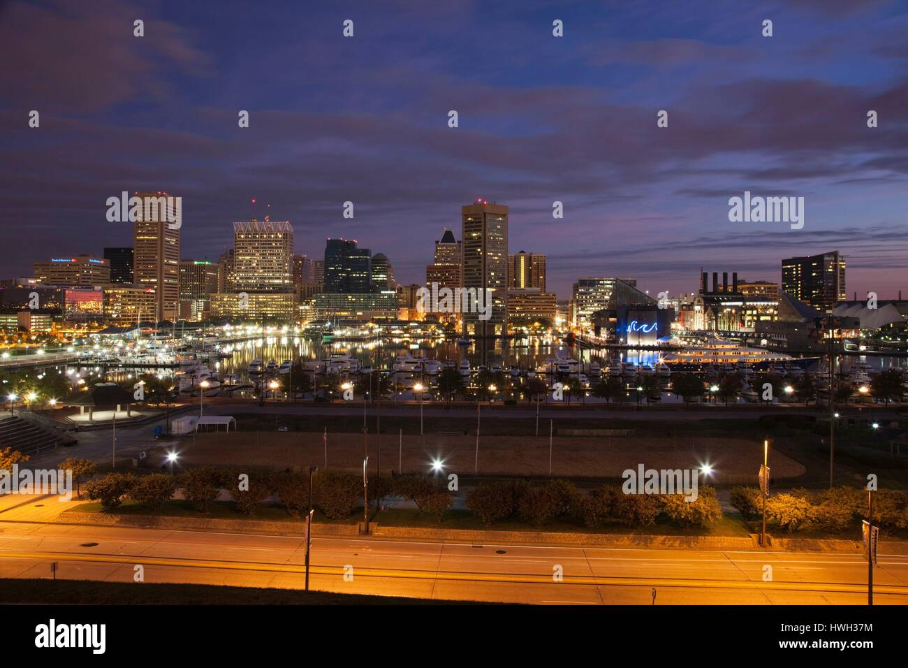 United States, Maryland, Baltimore, Inner Harbor, skyline from Federal Hill, dawn - Stock Image