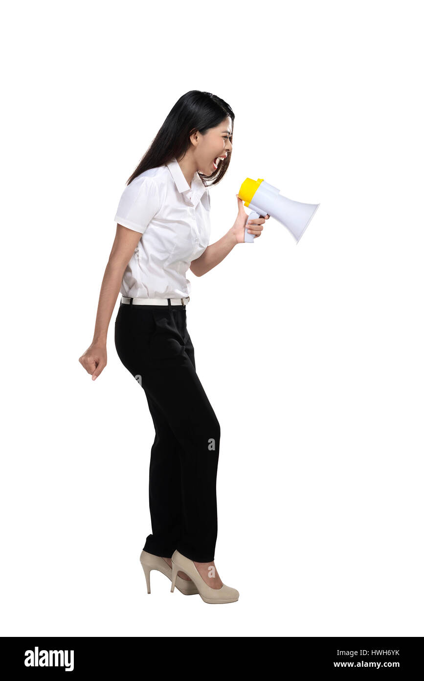 Asian woman holding megaphone isolated over white background - Stock Image