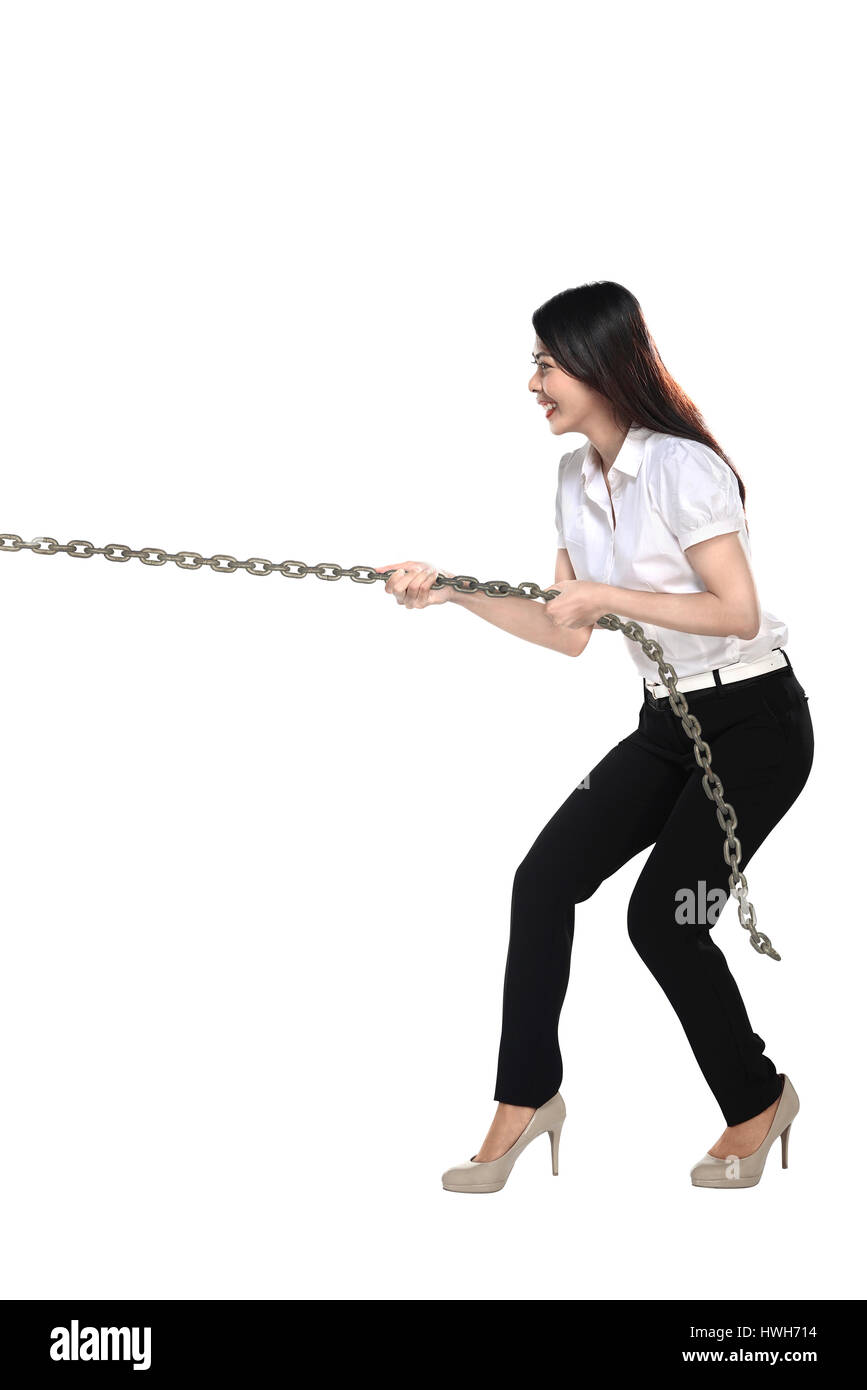Asian business woman pulling chain isolated over white background - Stock Image