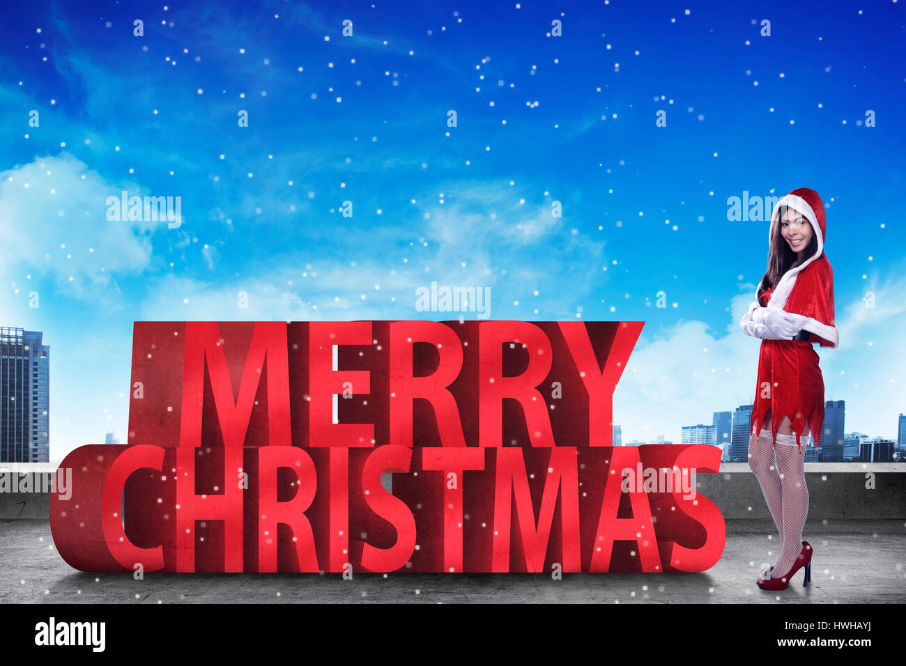 Pretty asian woman standing with merry christmas 3D text. Christmas ...