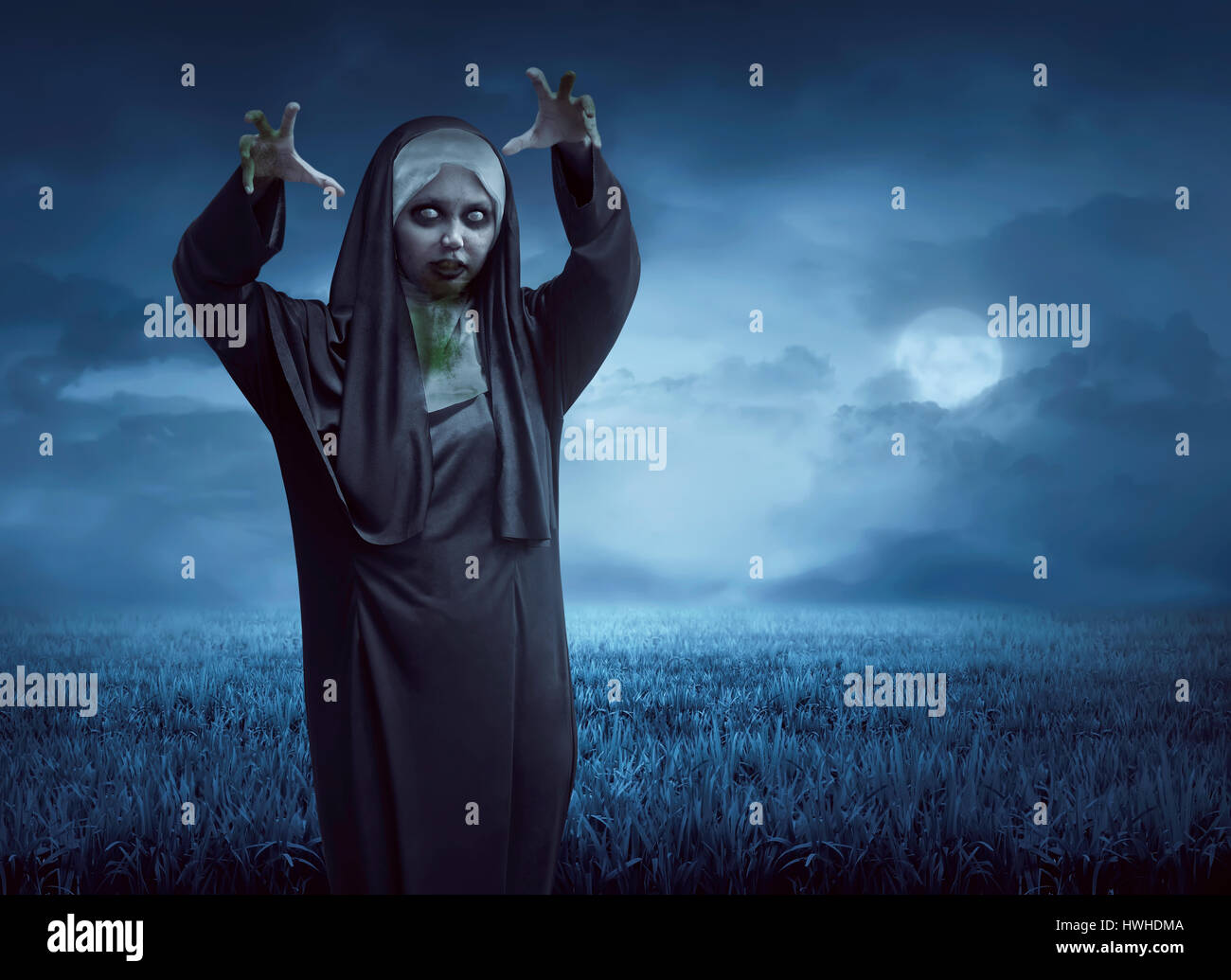 scary asian nun on a black cape standing in the moonlight stock