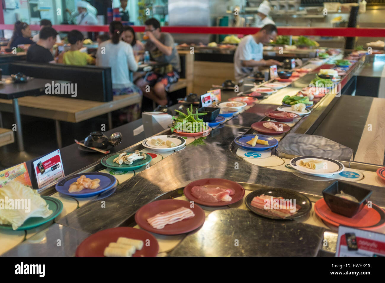 A conveyor belt sushi restaurant in Patong, Phuket, Thailand. - Stock Image