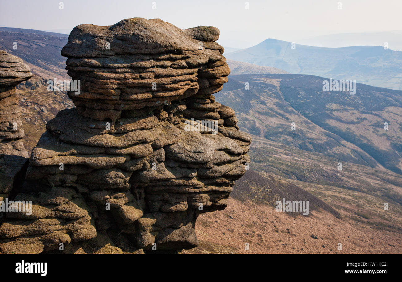 Weathered Millstone Grit rocks on Ringing Roger on Kinder Scout in the Derbyshire Peak District overlooking Edale - Stock Image