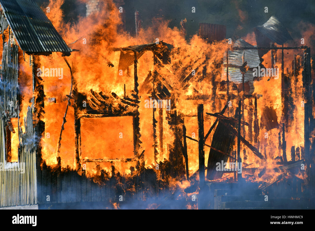 Close up of house destroyed by fire. - Stock Image