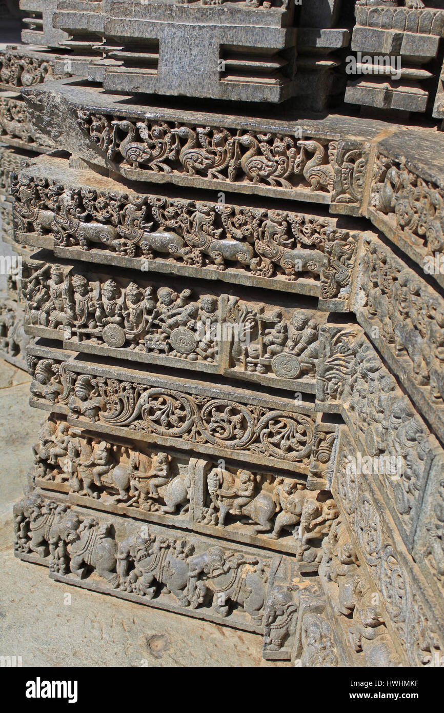 Ornamented detailed, stone carvings on Shrine wall. Relief sculpture follows a stellate plan, depicting Swans, makara(imaginary beast), Hindu puranas, Stock Photo
