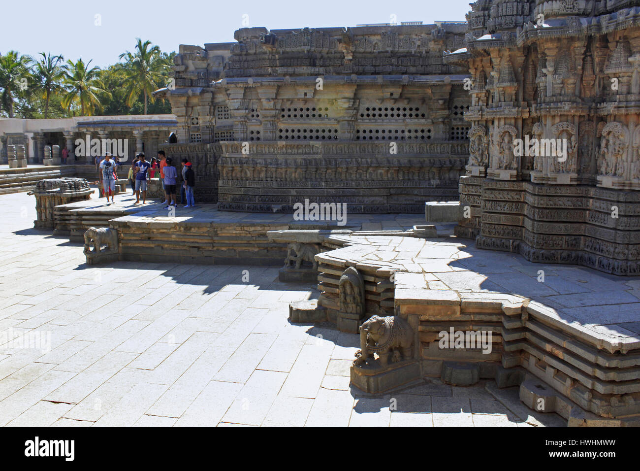 Wall relief, pierced windows and molding frieze, shrine wall follows stellate plan and pradakshina-patha is also raised on a molded star-shaped plinth Stock Photo
