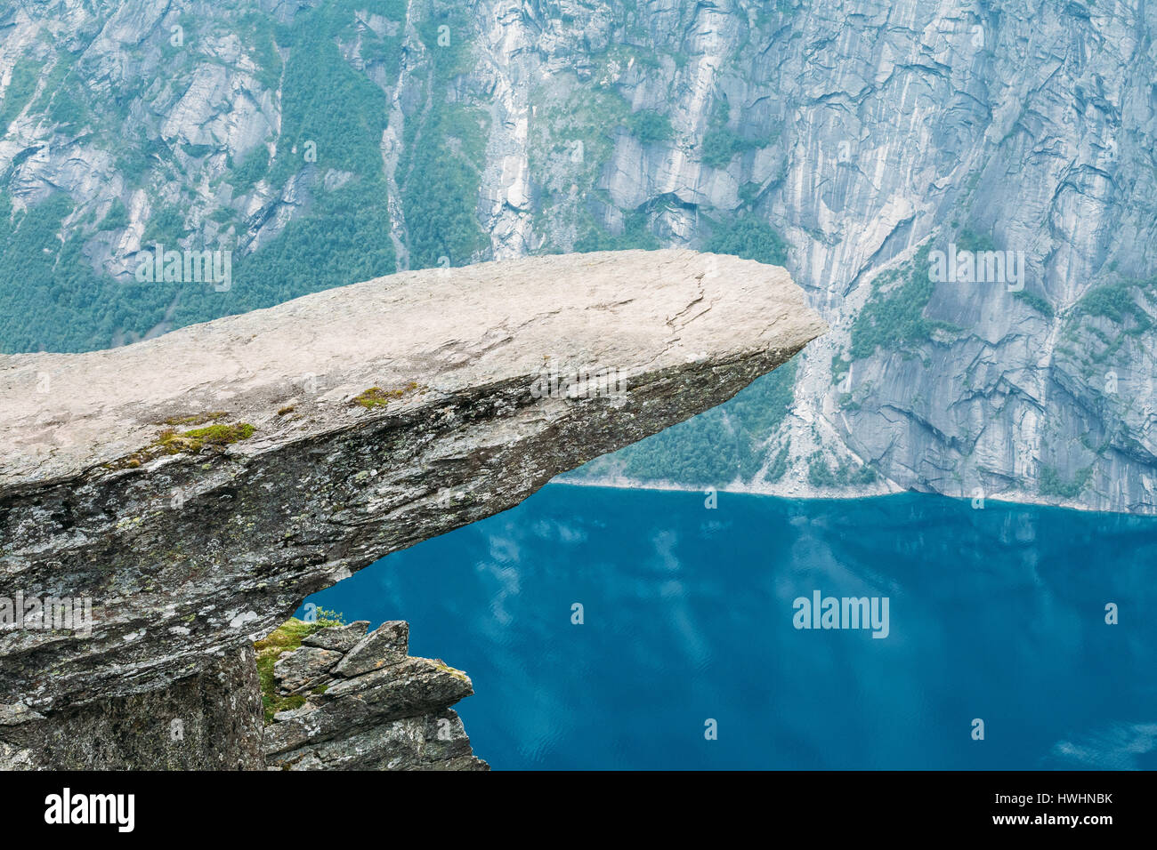Scenic View Of Rock Trolltunga - Troll Tongue In Norway. Rock In The Mountains Of Norway. Natural Attractions Landmark Stock Photo