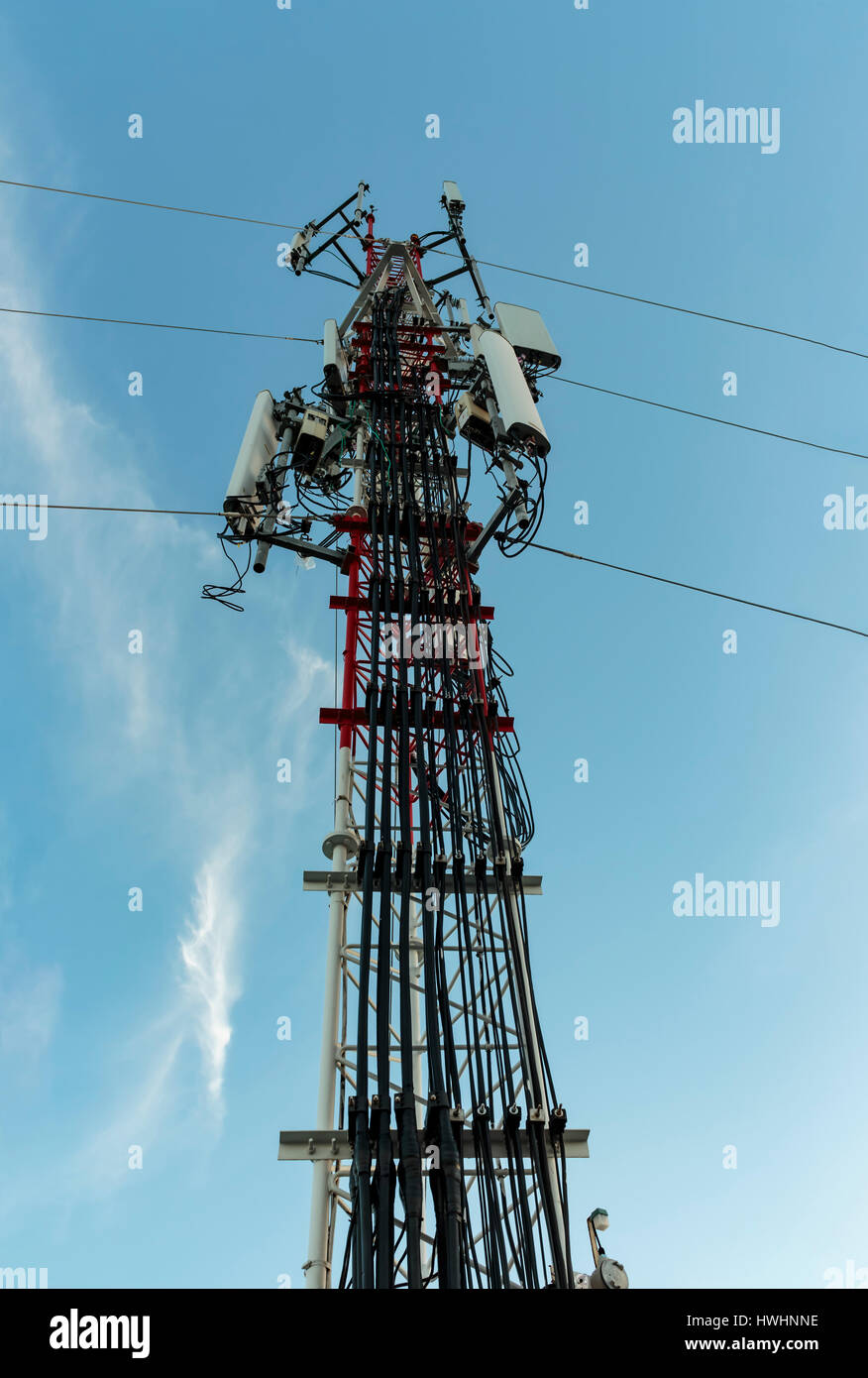 Signal Tower phone and sky background - Stock Image