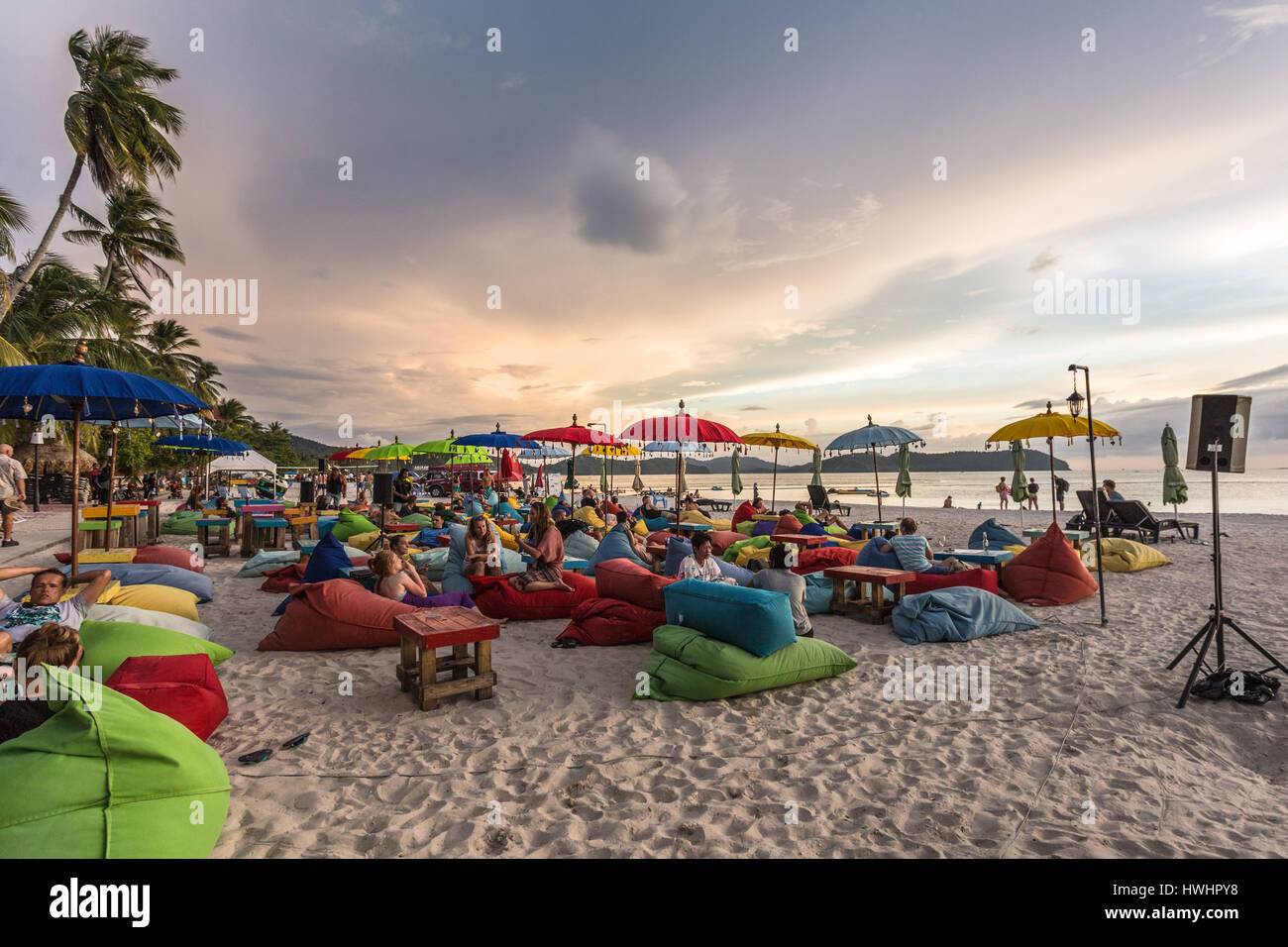 LANGKAWI, MALAYSIA - JANUARY 19, 2017: Tourists enjoy a drink in a beach bar on Cenang beach in Langkawi, an island Stock Photo