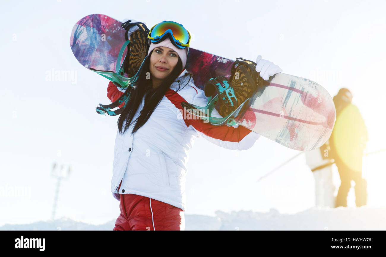 Young girl in ski suit - Stock Image