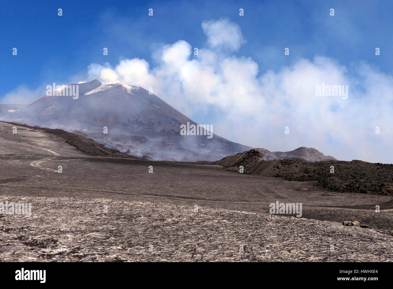 View of crater summit, snow, lava, smoke, magma and molten rocks. March 2017 eruption on Mount Etna in Sicily, southern - Stock Image