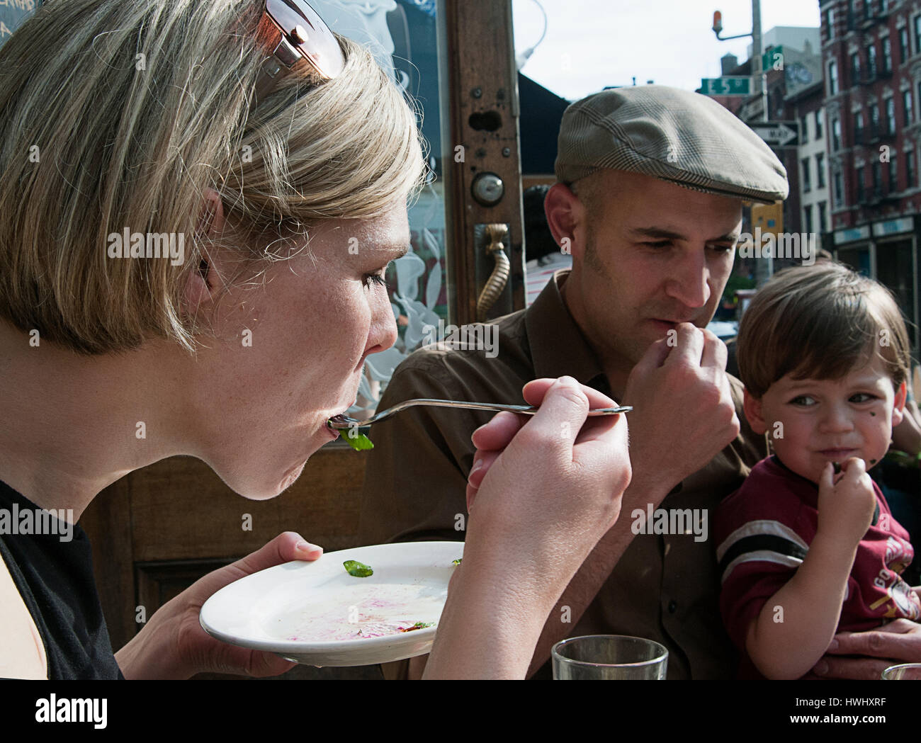 A family dining out in the East Village of Manhattan, New York City. - Stock Image