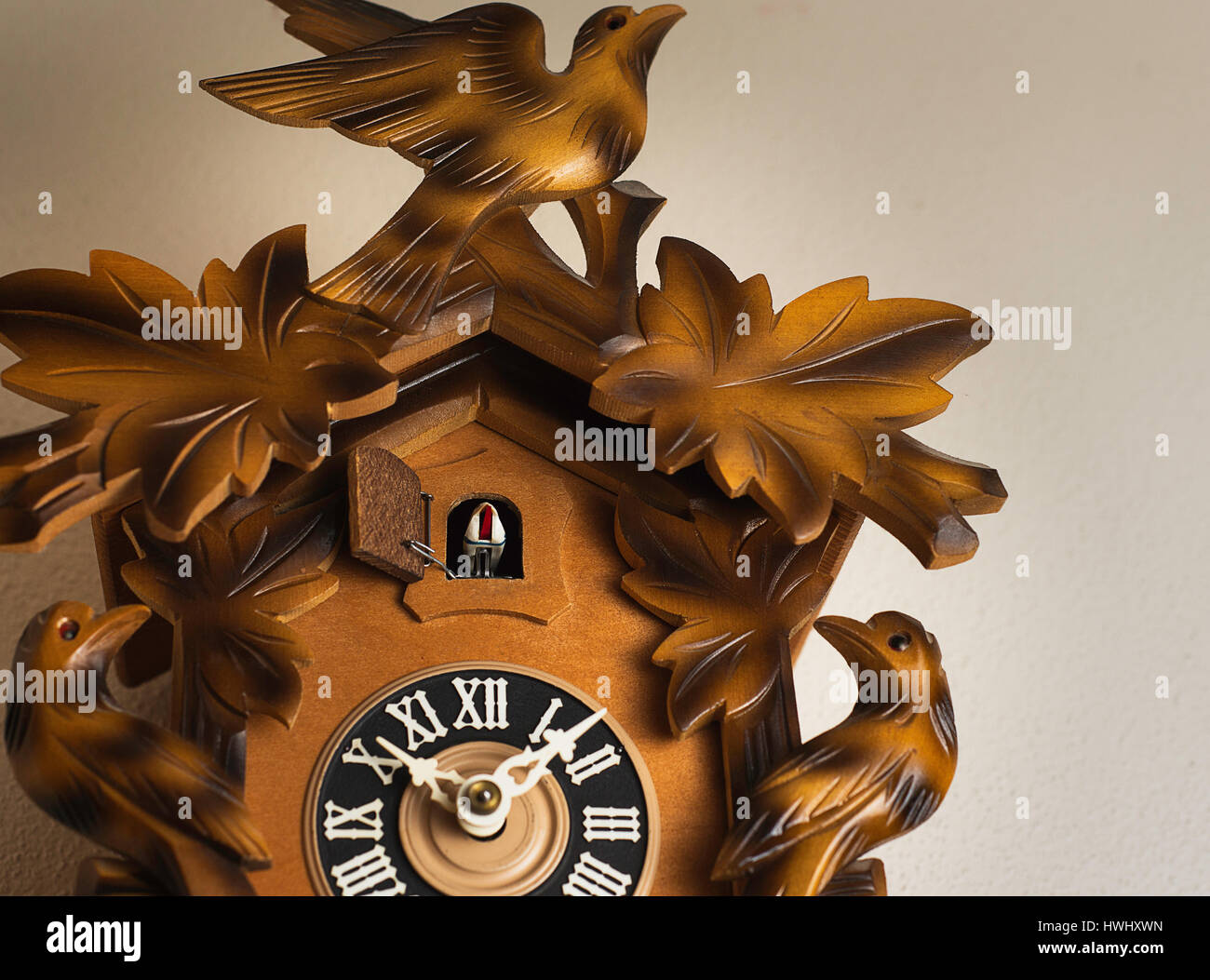 A cuckoo clock on a wall. - Stock Image