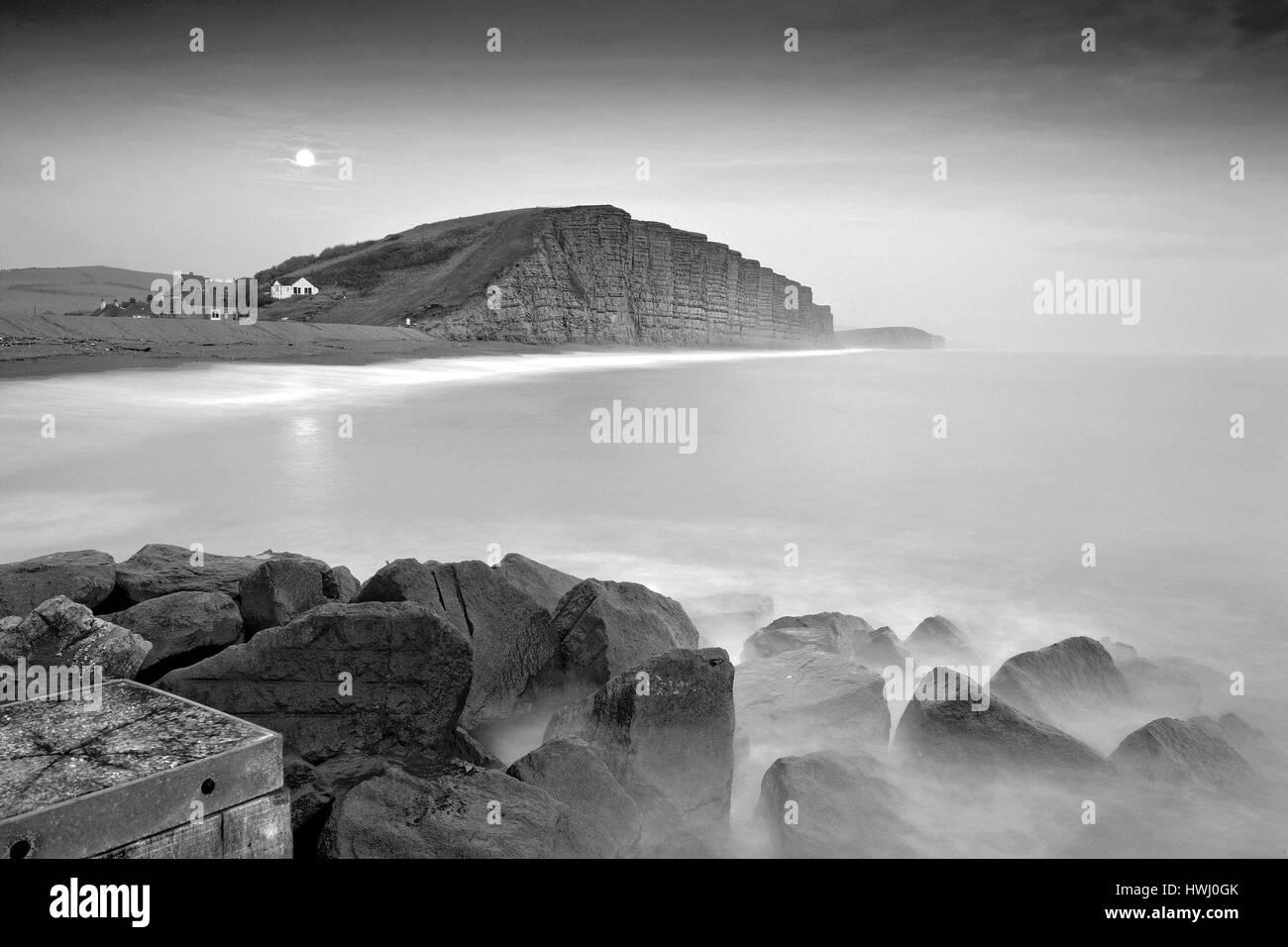 Moonshine at West Bay Dorset Blackand white - Stock Image