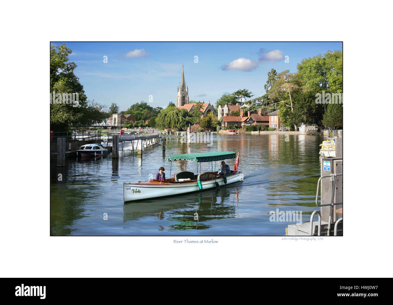 Steam boat on Thames at Marlow approaching lock - Stock Image