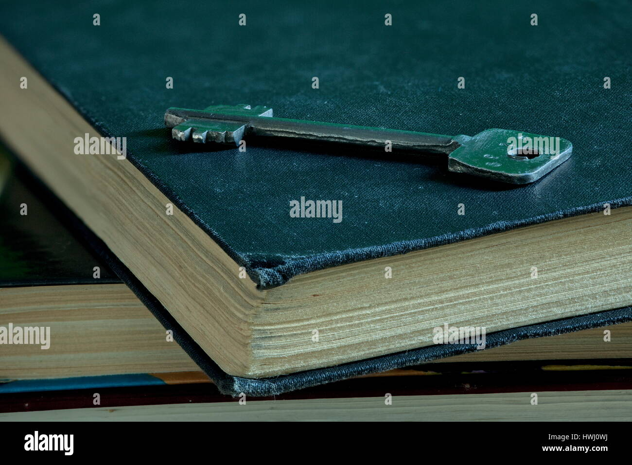 Iron key and old book Concept education discovery Knowledge wisdom - Stock Image