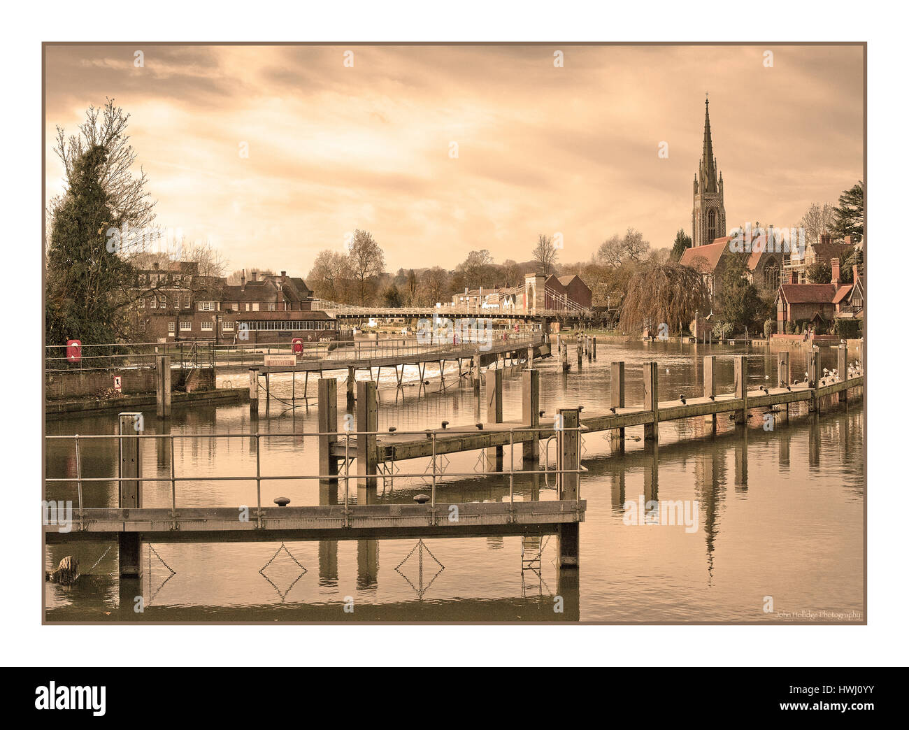 Sepia photo of Bridge at Marlow UK showing church and weir - Stock Image