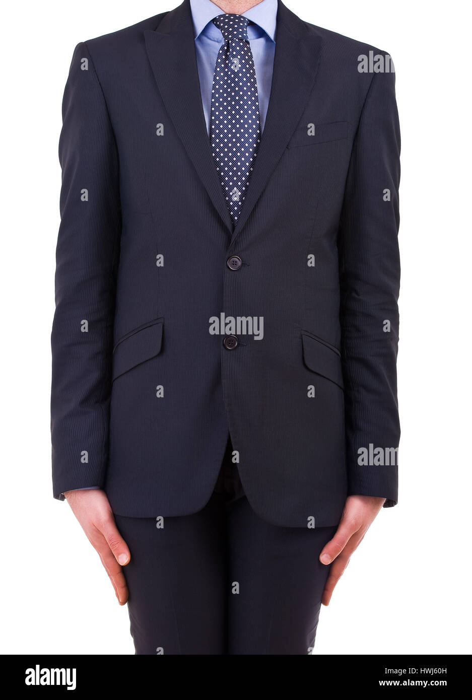 Businessman stands at attention. - Stock Image