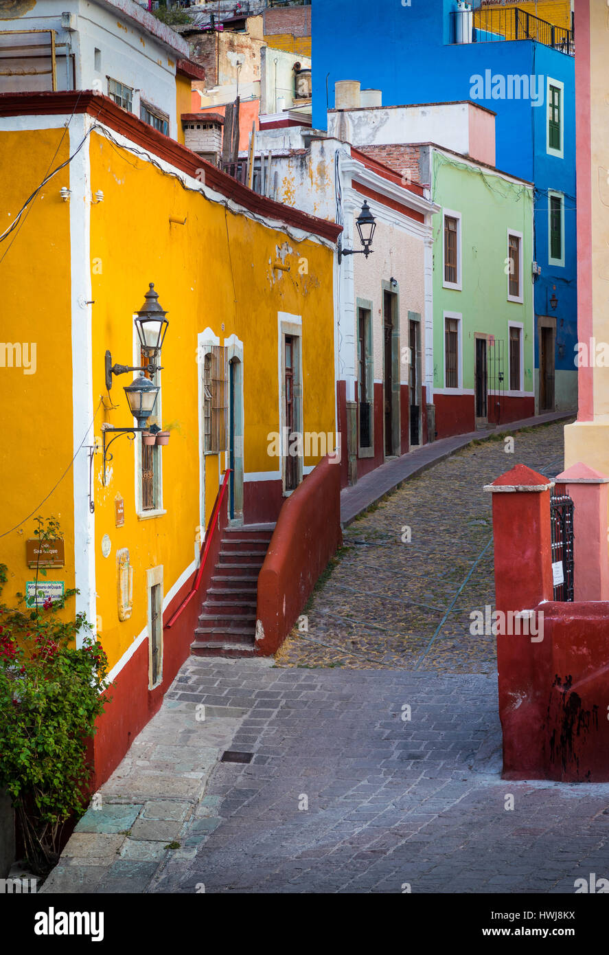 Typical colorful street in Guanajuato, Mexico with its Spanish colonial buildings. ------ Guanajuato is a city and - Stock Image