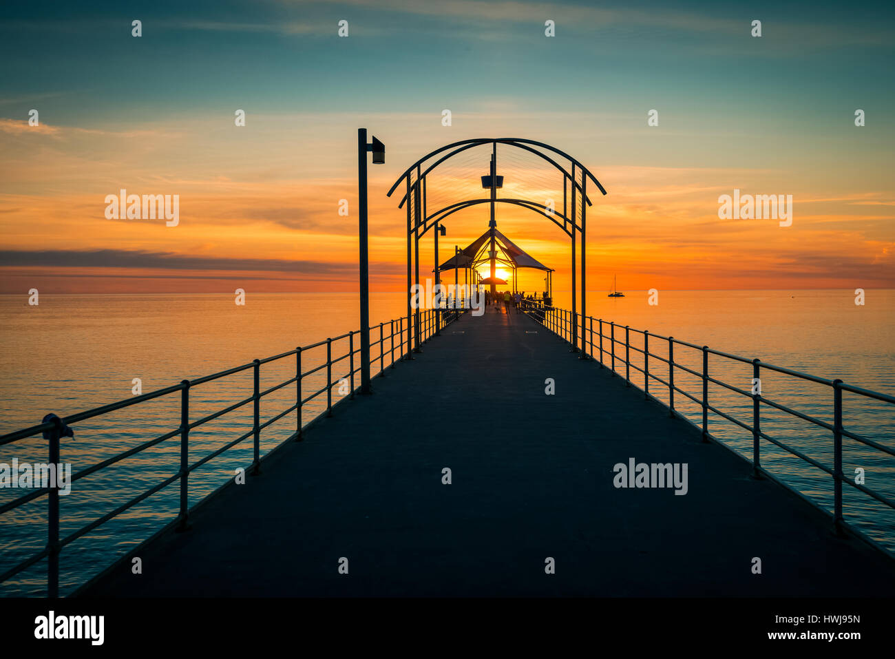 Adelaide, Australia - October 2, 2015: People walking along Brighton Jetty at sunset - Stock Image