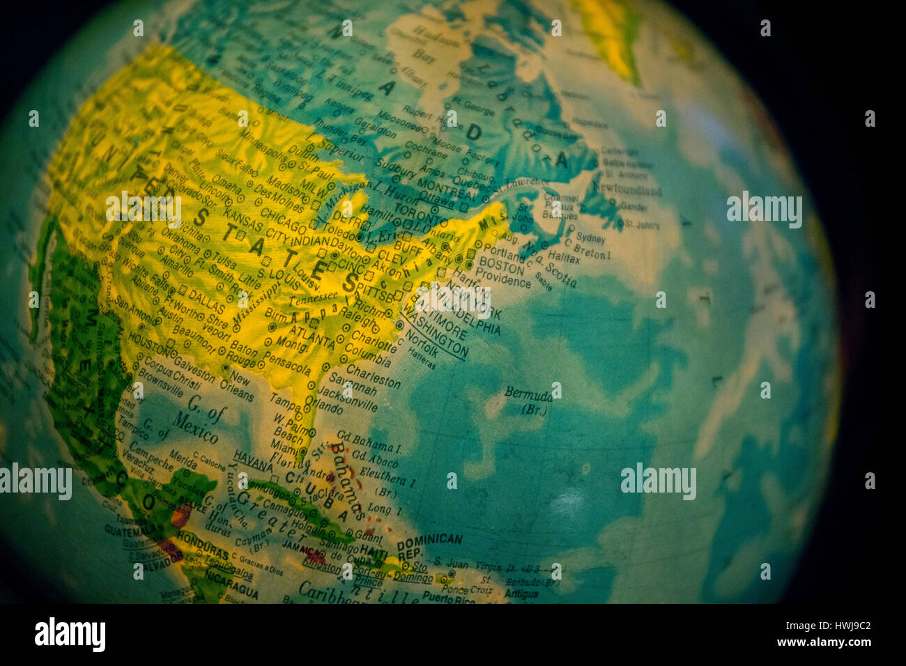 Close up of old fashioned world globe a ball shaped map lit from close up of old fashioned world globe a ball shaped map lit from within focusing on atlantic east coast north america canada gumiabroncs Images