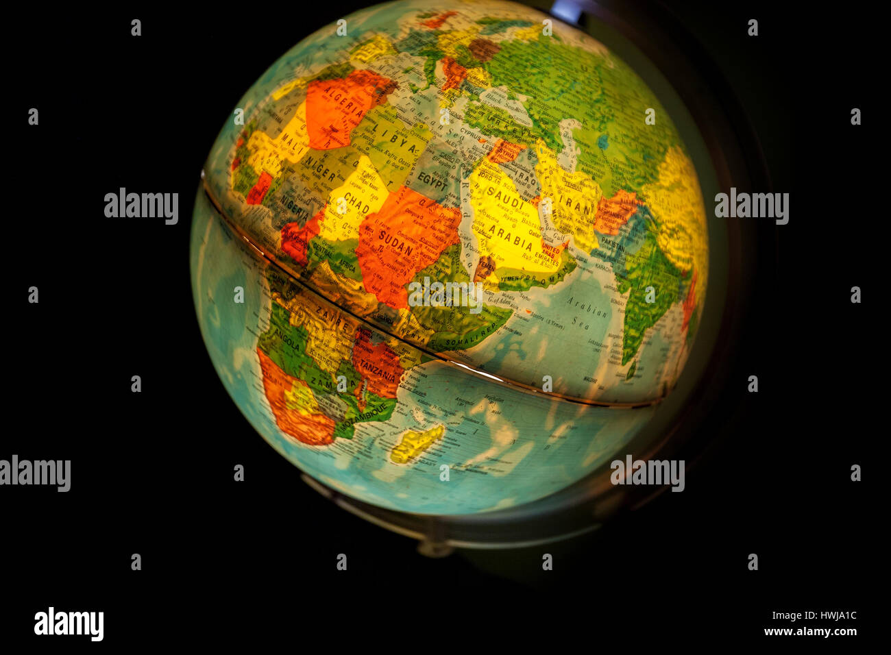 Close up of old fashioned world globe a ball shaped map lit from close up of old fashioned world globe a ball shaped map lit from within focusing on south africa and antartic gumiabroncs Images