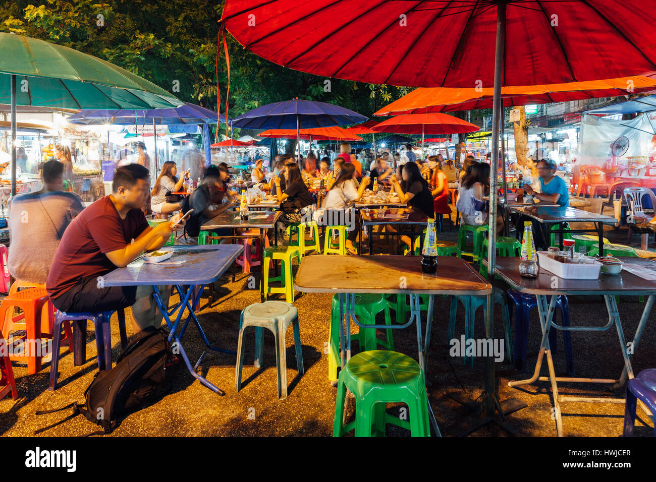 Chiang Mai, Thailand - August 27, 2016:  People eat at the street cafe on Saturday Night Market on August 27, 2016 - Stock Image