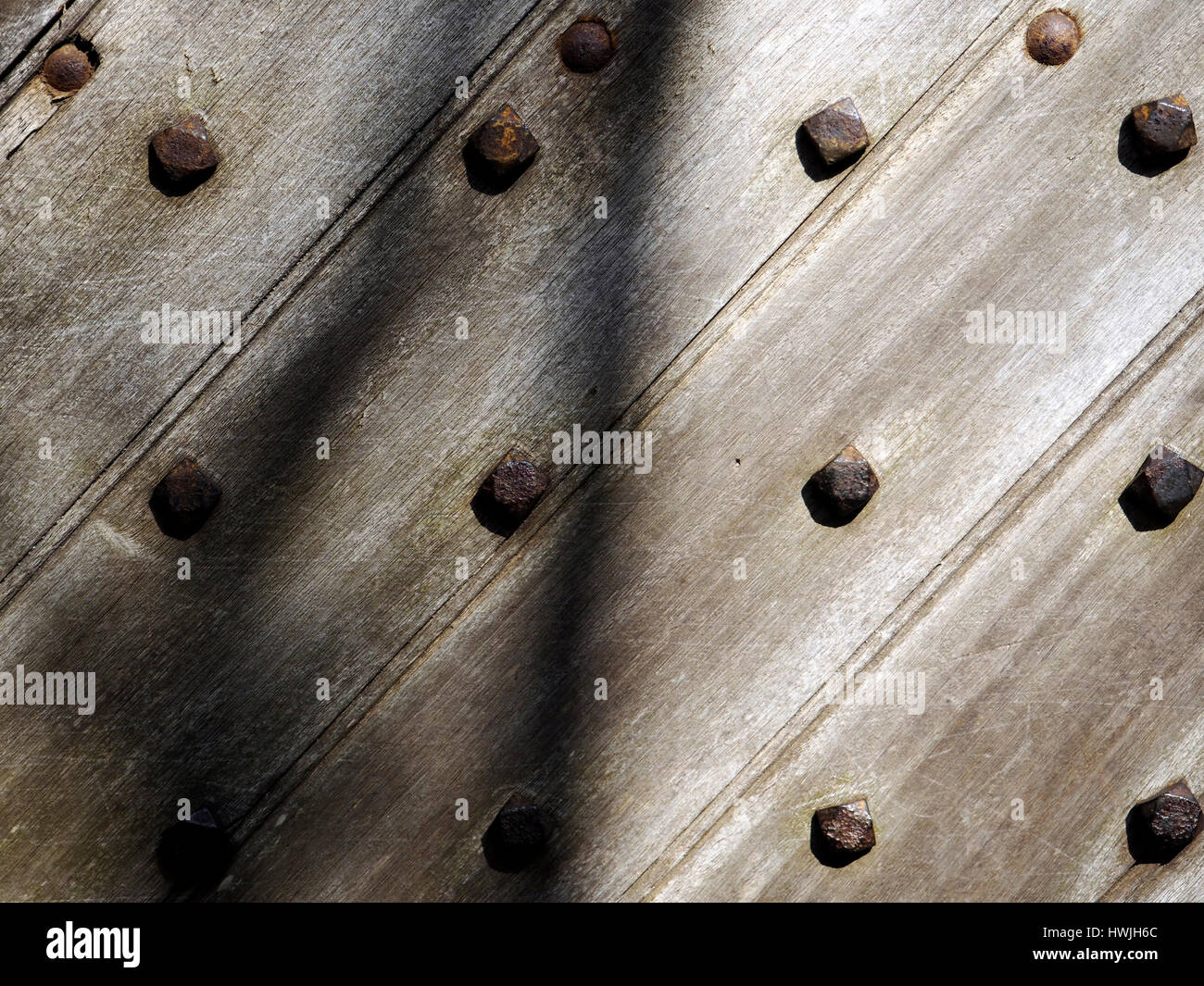 Detail of an oak church door constructed using large hand-made iron nails. - : slanting door - pezcame.com