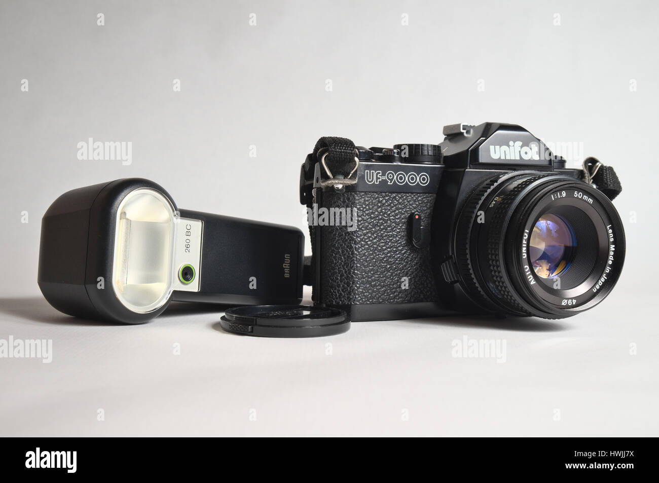 Old Unifot analogue camera, model UF-9000. 35mm film compact camera, with 50mm Unifot K-mount lens f/1.9 - Stock Image