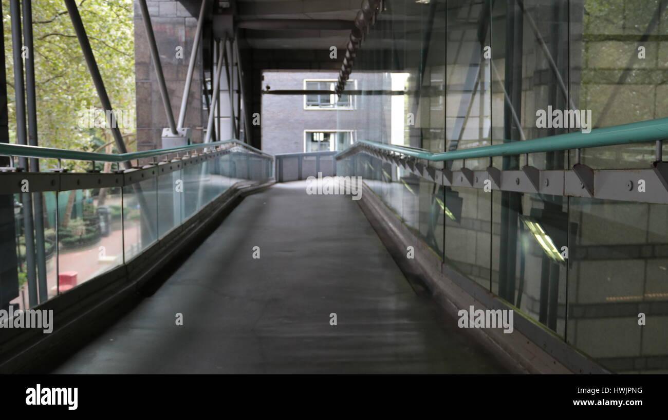 a glass walkway empty of anyone no people - Stock Image