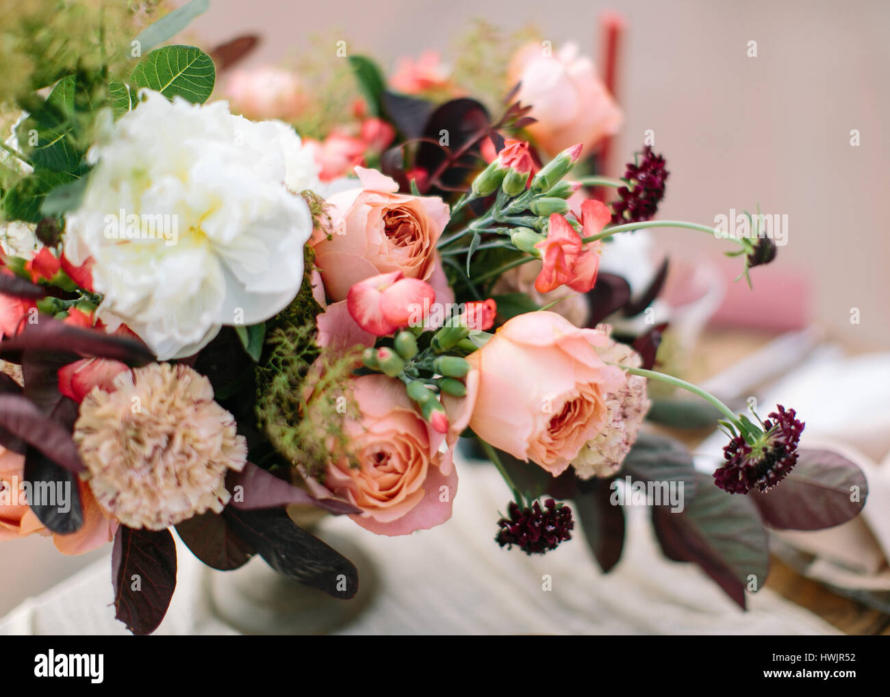 Wedding Flowers Composition In Peach Pink Purple And Claret Tones