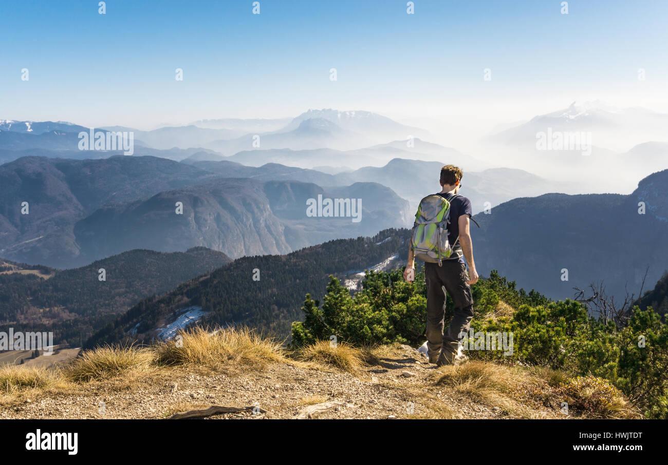 Man walking hiking on mountain trail. Great view. - Stock Image