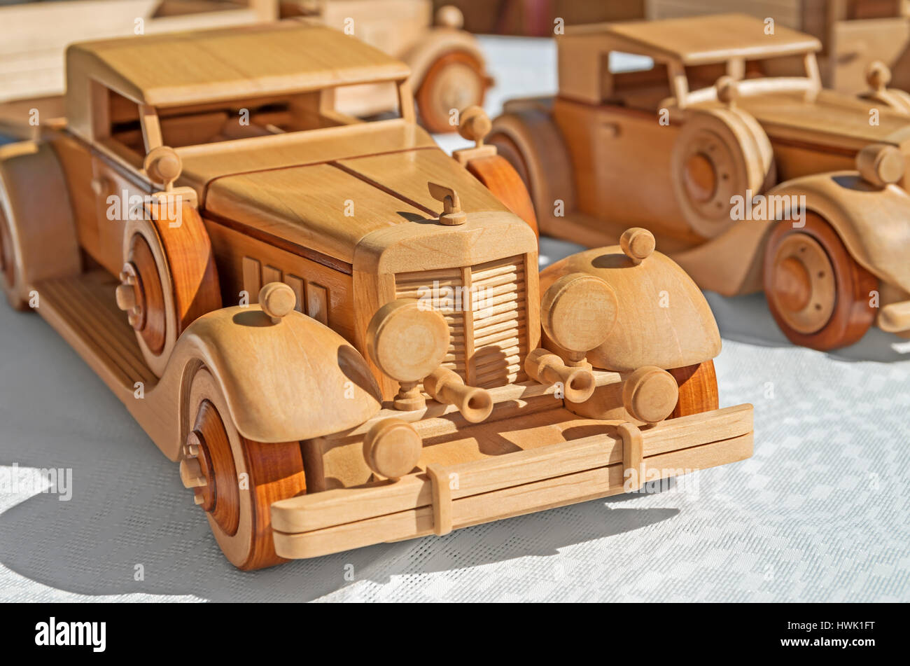 Wooden model of retro executive cars on a white background - Stock Image